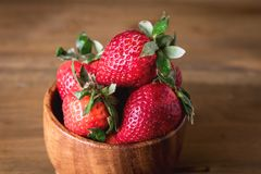 Fresh Tasty Strawberries in Wooden Bowl Wooden Rustic Background Close Up.  Stock Image