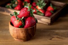 Fresh Tasty Strawberries in Wooden Bowl Wooden Rustic Background Copy Space.  Stock Images