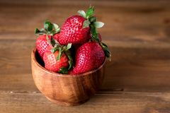 Fresh Tasty Strawberries in Wooden Bowl Wooden Rustic Background Copy Space.  Stock Photography