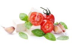 Fresh and tasty tomatoes, basil, mozzarella and garlic.Caprese salad . Fresh and tasty tomatoes, basil, mozzarella and garlic.Caprese salad isolated on white Royalty Free Stock Photography