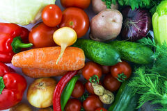 Fresh tasty vegetables on rustic table Stock Images