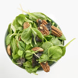 Fresh tatsoi salad with pekan nuts and prunes Royalty Free Stock Images