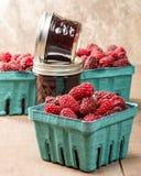 Fresh Tayberries and jars of homemade jam Stock Photo