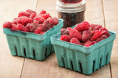 Fresh Tayberries and jars of homemade jam