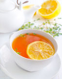 Fresh tea. With lemon in the white cup Royalty Free Stock Photo