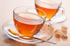 Fresh tea and cane sugar Stock Photo