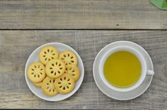 Fresh tea in cup with cookies on wooden table royalty free stock images