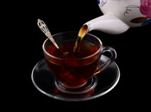 Fresh tea pouring isolated Royalty Free Stock Photography