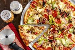Fresh Thin Crust Supreme Pizza Stock Photo