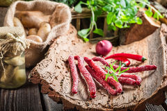 Fresh thin sausages in cellar Royalty Free Stock Photography