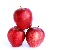 Fresh three red apples isolated Royalty Free Stock Photos