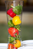 Fresh Three sweet Red, Yellow, Green Peppers in jar Stock Image