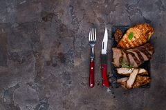 Fresh three types of grilled steak chicken, pork, beef on slate plate with herbs. On stone background with copy space, flat lay Stock Photography