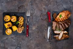 Fresh three types of grilled steak chicken, pork, beef on slate plate with spinach, corn grill and grilled potatoes. Fresh three types of grilled steak chicken Royalty Free Stock Photography