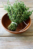 Fresh thyme in a bowl on wooden boards Royalty Free Stock Photography