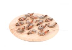Fresh tiger shrimps on platter. Royalty Free Stock Photo