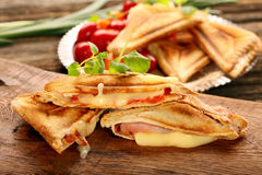 Fresh toast with cheese, ham and tomato stock images