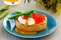 Fresh toast with poached egg, caviar Royalty Free Stock Images