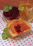 Fresh toasts with strawberry jam and tea Stock Image