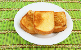 Fresh toasts on white plate Royalty Free Stock Photo