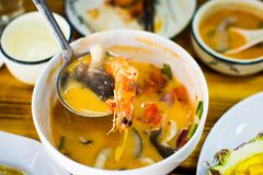 Fresh Tom Yum Gong soup served on the table. Fresh Tom Yum Gong soup served on big bowl on the table stock images