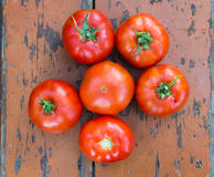 Fresh tomates dry surface vintage table Royalty Free Stock Image