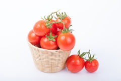 Fresh tomato. In a basket isolated on white background Royalty Free Stock Photos