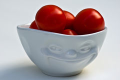 Fresh tomato in bowl Stock Images