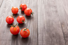 Fresh tomato on the brown wooden background. Top view Stock Image