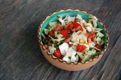 Fresh tomato and cabbage salad with parsley in ceramic bowl Stock Photo