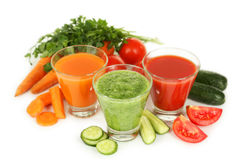 Fresh tomato, carrot and cucumber juice isolated on white. Royalty Free Stock Photos