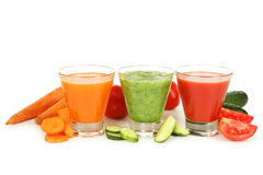 Fresh tomato, carrot and cucumber juice isolated on white. Royalty Free Stock Photography