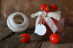 Fresh tomato cherry in a glass jar Stock Photography