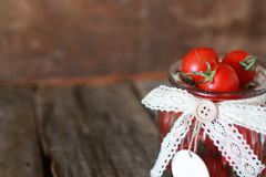 Fresh tomato cherry in a glass jar Stock Photo