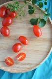 Fresh tomato on circle tray Royalty Free Stock Photography
