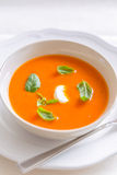 Fresh tomato cream soup garnished with basil Stock Photography