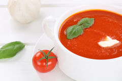 Fresh tomato cream soup with tomatoes in bowl Royalty Free Stock Photos