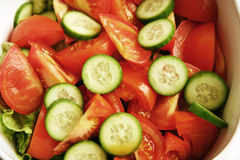 Fresh tomato and cucumber salad. Mixed together royalty free stock photos