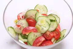 Fresh Tomato Cucumber Salad. Sliced cucumbers and fresh raw tomatoes mixed together in a salad bowl Royalty Free Stock Images