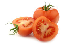 Fresh tomato and a cut one Royalty Free Stock Images