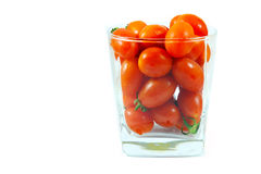 Fresh tomato in glass Royalty Free Stock Photography