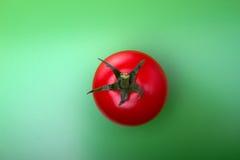 Fresh tomato on green Royalty Free Stock Photo