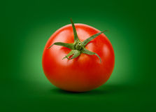 Fresh Tomato. On Green Background Royalty Free Stock Image