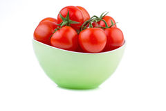 Fresh tomato in green bowl Stock Images