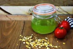 Fresh tomato green juice drink tea mason jar oats kitchen cloth wooden rustic surface food breakfast healthy organic Royalty Free Stock Image