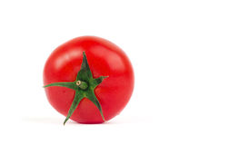 Fresh tomato with green leaves isolated on white background Royalty Free Stock Image