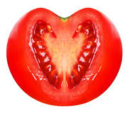 Fresh tomato with heart shaped cutted section Royalty Free Stock Image