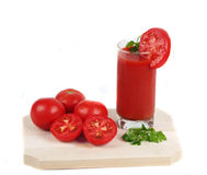 Fresh tomato juice. With tomatoes cut Stock Images