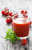Fresh tomato juice. And basil Stock Image