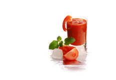 Fresh tomato juice in the glass royalty free stock photography